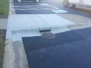 Sidewalk Curb Drain After